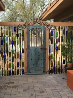 Blue Bottle Trees & Garden Sculpture  I love this, I would definitely make this the entry to my court yard.