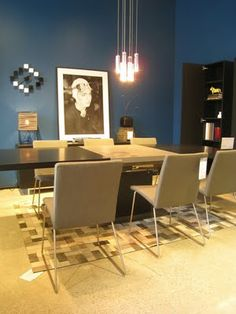 BoConcept Expanding dining table with Mariposa Delight chairs and Futuna chandelier