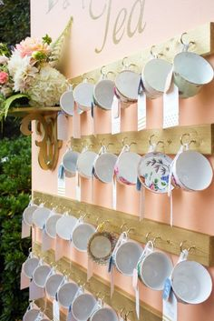 If your wedding theme is vintage, use pretty antique teacups as escort cards for a romantic touch.