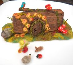 Hollow Log Fairy Tree House Waldorf Play Mat Play Scape Needle Felted Play items. $57.00, via Etsy.