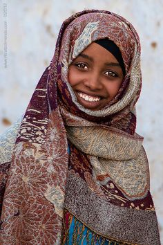 Nubian girl -- the Nubian region of Africa coincides with the Nile.  It includes the southern end of Egypt or the northern part of Sudan.