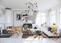 salon blanc nordique avec chaises, tabourets et tables de style scandinave