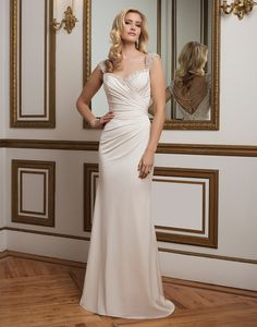 Justin Alexander wedding dresses style 8820 Hand beaded sweetheart neckline and straps adorn this soft, asymmetrically draped straight jersey gown. The detachable crystal and pearl back detail recreates Old Hollywood glamour for the red carpet bride.