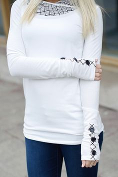 Long sleeve tunic with criss-cross pattern mesh hood and button detailed cuffs. Ivory