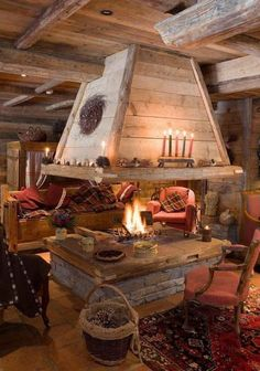 cabin fire place ideas. I love the fire being in the middle of the room, theyre never there :)
