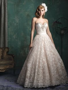 STYLE: C349  Lace and Swarovski crystals adorn this classic ballgown.
