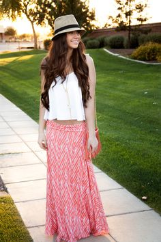 Fedora, tribal maxi skirt, white crop top, oia Jules, Bellami hair extensions, coral fringe bag