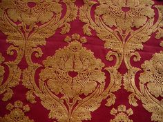 Deep red ground with bright gold chenille damask design 1.25 yards