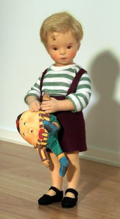 """Cole"" R. John Wright introduces the PLAYTIME COLLECTION - an exclusive Collector Club series featuring children and their toys. The first doll in this series is the little boy shown here named ""Cole."" This darling toddler is made entirely of the finest all-wool felt and measures just 11 1/2"" tall - an exciting new cabinet-size from R. John Wright Dolls."