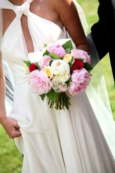 Bouquet of pink and white peonies, hot pink milano rose, pale yellow vanilla sky rose and simple foliage