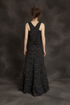 Alabama Chanin.  Love the gray on black (it's reverse applique-does that make it black on gray?) skirt.