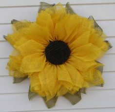This cheery flower wreath would be the perfect gift for the sunflower lover in your life! Choose between the paper mesh sunflower which