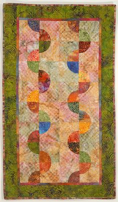 Do you admire quilts made with curved seams but are afraid to tackle one? Try this easy modern Drunkard's Path variation without templates or matching seams.