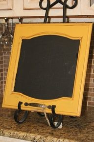 Repaint and distress old cabinet door, apply chalkboard paint in the center. So cool. #food