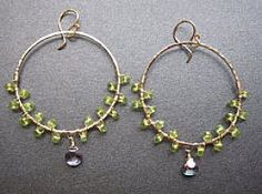 "Large hoops wrapped with peridot and blue topaz, about 2-1/4"" long. Available in 14k gold stuffed & sterling silver"