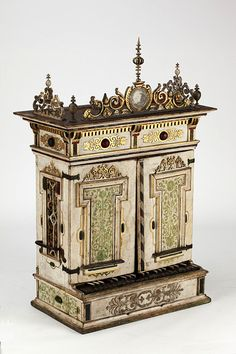 Positive organ        Place of origin:        Dresden, Germany (probably, made)      Date:        1627 (made)      Artist/Maker:        Fritzsche, Gottfried, born 1578 - died 1638 (attributed to, maker)      Defrain, Tobias (restorer)      Materials and Techniques:        Pine case, carved, painted and gilt; birch keys, slides and windchest; paper organ pipes