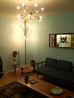 Mid Century Modern Living Room with Sputnik Ceiling Light AND a Sputnik tension pole lamp! & Shadow Box - Love that shadow box shelf! Blenko bottle, Catherine Holm dish, teak, Danish modern, Lucite grapes cluster.