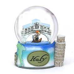"This beautiful keepsake snow globe features the Venice Rialto Bridge and Gondola along with the Leaning Tower of Pisa, the Italy ""Boot"" and Rome's Colisseum, all on the base. Great souvenir and gift"