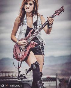 Lexii Lynn Frazier  guitarist / model / RTFO-endorsed artist. Wearing RTFO Skeleton Sign Language tank.  #rock #heavymetal #metal #metalstyle #rockstyle #metaloutfit #guitar #stage #PRS #jean #denim #jacket #chain #shorts
