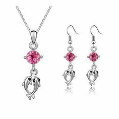 "Blue Chip Unlimited - Elegant Crystal Dangling Dolphin Pendant in Rose Pink with 18k White Rolled Gold Plate 18"" Chain and Matching Earrings Fashion Jewelry Pendant Necklace Blue Chip Unlimited. $34.95. Please Note: For Pierced Ears Only. Perfect gift for every occasion!. Rose Pink Dangling Dolphin Crystal Pendant Necklace & Earrings Set. Brand New Item!. Matching Necklace & Earring Set. Save 65% Off!"