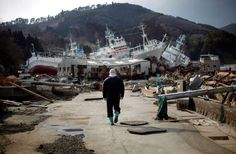 A man walks next to port area destroyed by the earthquake and tsunami in Kessenuma town, in Miyagi p... - REUTERS/Carlos Barria