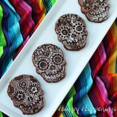 Sugar skull BROWNIES that is just genius. Now I'm sold on those cutters. UPDATE: following her directions you get brownies the thickness of a cookie. They were weird, not very good. Looked cute though. Might try again with normal thickness brownies. | Hungry Happenings: Bake Sugar Skull Brownies to celebrate Day of the Dead