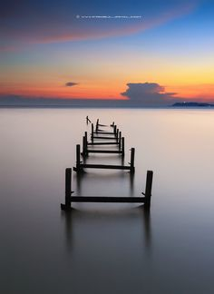 Sunset at broken jetty. Stock photo available for download at 500px.com