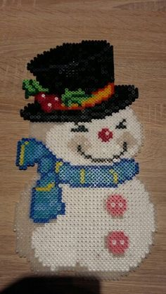 Hama Snowman Ironing Beads Hama Snowman Ironing Beads Gifts: Christmas is coming Christmas or the Christ event, the Event of lights, the Feast of p. Pokemon Perler Beads, Pearler Beads, Fuse Beads, Melty Bead Patterns, Perler Patterns, Beading Patterns, Elephant Blanket, Beading For Kids, I Love This Yarn