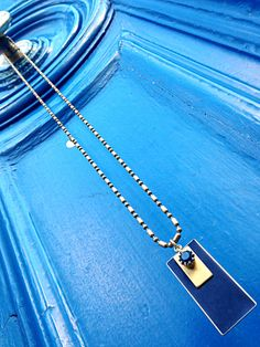 Natanè Planet necklace on a doorway in Paris. #necklaces #collane #colors #blue #door #fashion #style #outfit #Swarovski #jewels #bijoux.