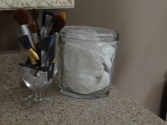 "Water goblet for  make-up brushes, empty Yankee Candle covered jar if in a place where moisture may be an"" issue for your tissue"" ;)"