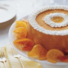 This incredibly light cake is decorated with beautiful creme-fraiche piping and served with candied grapefruit and orange slices.