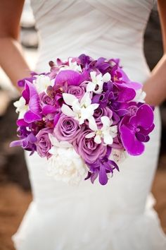 Purple and white bridal bouquet | 12 Stunning Wedding Bouquets via @BelleMagazine