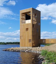 This lakeside observation pavilion by Finnish studio OOPEAA doubles as a giant…
