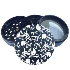 This is a floral pattern design engraved into Black 55mm Multi-tooth Custom Herb Grinder. This smoking accessory is one of the most badass top shelf grinders in the cannabis industry today to make your own grinder check out customherbgrinders.com