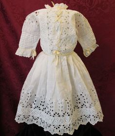 Lovely 19th century antique doll dress with beautiful broderie anglaise, pin tucks on sleeves, yellow satin ribbon interwoven in eyelet design and a