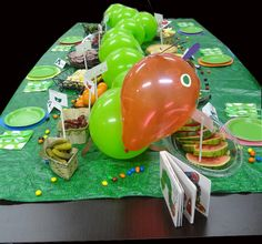 """Once you've made the caterpillar, just place on top of a grass or leaf printed tablecloth, festive plates and silverware to make this """"Very Hungry Caterpillar party"""" a munch worthy event! #EricCarle #VeryHungryCaterpillar"""