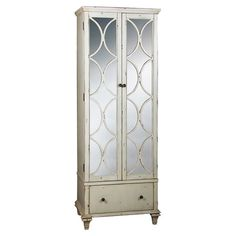Perfect for stowing your favorite wines and glassware, this stylish bar cabinet features mirrored doors, 2 drawers, and 10 bottle slots.
