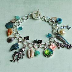 Beach Summer Mermaid Bracelet, Abalone Shells, Cowie Shell, Tibetan Silver Charms, Green Blue Turquoise Ivory Beads Jewellery by BettysJewelleryBox on Etsy https://www.etsy.com/uk/listing/521861671/beach-summer-mermaid-bracelet-abalone