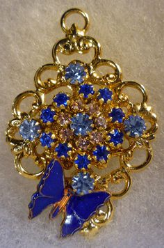 Handset Swarovski Rhinestone & Butterfly pendant: http://www.outbid.com/auctions/7607-boredbrawd-s-swarovski-beauties-beads#49