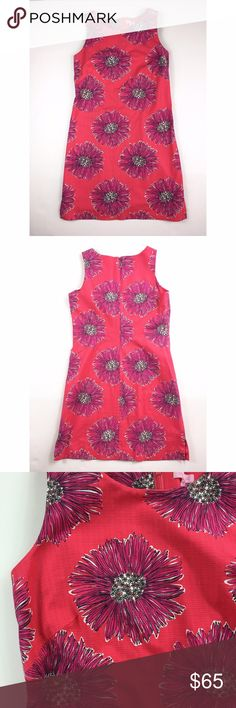"""Lilly Pulitzer Bright Pink Flower Dress Lilly Pulitzer bright pink big flower dress. Size 10. 98% cotton 2% XLA Lastol. Fully lined. Heavy material. Back hidden zipper. Armpit to armpit: 18"""" Length: 37"""" Lilly Pulitzer Dresses"""