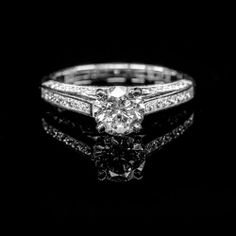 This Exquisite Bucci Channel and Pavae Engagement Ring with a Round Cut has a Center Weight of 1.00 Carat a Mount Weight of .54 Carat's and a Total Weight of 1.54 Carat's, G Color, SI2 Clarity, Excellent Cut Class, Very Good Polish and Excellent Symmetry; Featured on an 14K White Gold Band. The GIA Certification No. is 5126366208. This Ring is a part of our Vero Amor Collection.