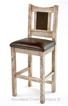 Barn Wood Bar Stool in Distressed Gray placed at the end of a barn wood table for guest to visit you while you are cooking.  Compliments the outdoor antique theme of the kitchen.