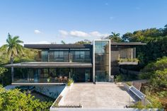 Charred teak wood clads Costa Rica house with views of the Pacific Ocean. Nosara, Exterior Cladding, Wood Cladding, Houses In Costa Rica, Passive Design, Charred Wood, Timber House, House Entrance, Flat Roof