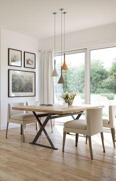 Eine Schlichte Essecke Mit Einem Großen Fenster Zum Garten. Hier Wird  Elegant Gegessen Und Lange