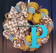 Love chevron? This is for you! The base is natural burlap, wrapped with mustard burlap, gray and white chevron, turquoise wired chevron and window