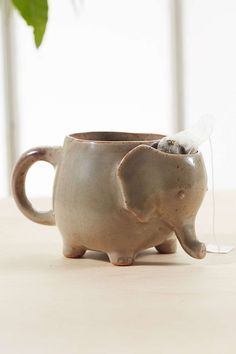 Plum & Bow Elephant Tea Mug New unopened ceramic elephant tea mug, from Urban Outfitters. Has a little compartment to place your tea bag after you're done brewing your tea. Diameter - , Height - Urban Outfitters Other Elephant Mugs, Elephant Love, Ceramic Elephant, Cute Mugs, Cute Tea Cups, Tea Party, Betta, Coffee Cups, Cool Stuff