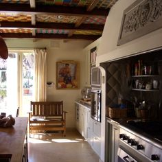 Spanish tiles in between ceiling beams gorgeous mission style kitchen