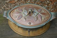 Serve food straight from the oven to the table in this beautiful handmade ceramic casserole dish. This piece is made on the potters wheel, the