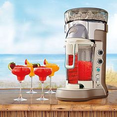 Enjoy margaritas, daiquiris, coladas, and more mixed up in the Margaritaville Bali Frozen Concoction Maker. With one push of the dispensing lever after loading up the ingredients, your frozen drink is mixed and dispensed perfected into your glass. Party Drinks, Fun Drinks, Beverages, Cocktails, Refreshing Drinks, Summer Drinks, Cold Drinks, Alcoholic Drinks, Margaritaville Frozen Concoction Maker
