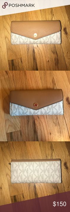 Michael Kors envelope wallet Michael Kors wallet in outstanding condition. Used but extremely loved and well taken care of. 10 slots for credit cards, a slot for money, an interior zipper with large pocket and a back pocket!! Michael Kors Bags Wallets